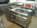 cocina de dos fuegos con horno repagas. modulo de cajones hechos a medida